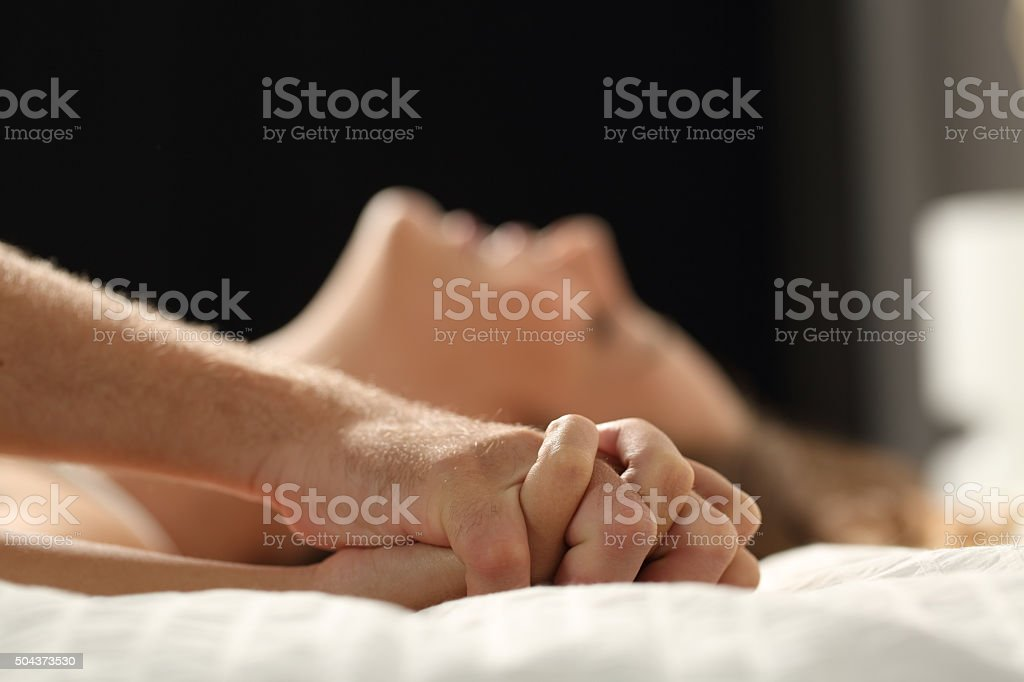 Couple having sex on a bed at home stock photo