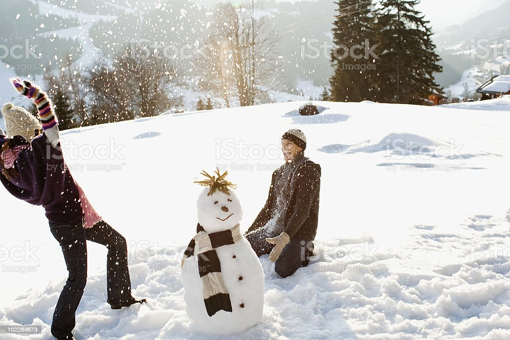 Couple having snowball fight royalty-free stock photo