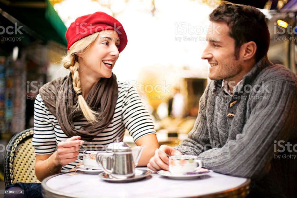 Couple having tea in cafe stock photo