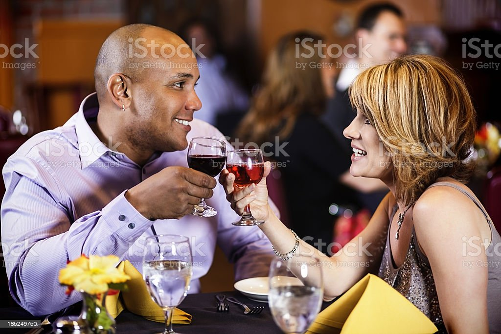 Couple Having Wine in a Restaurant royalty-free stock photo