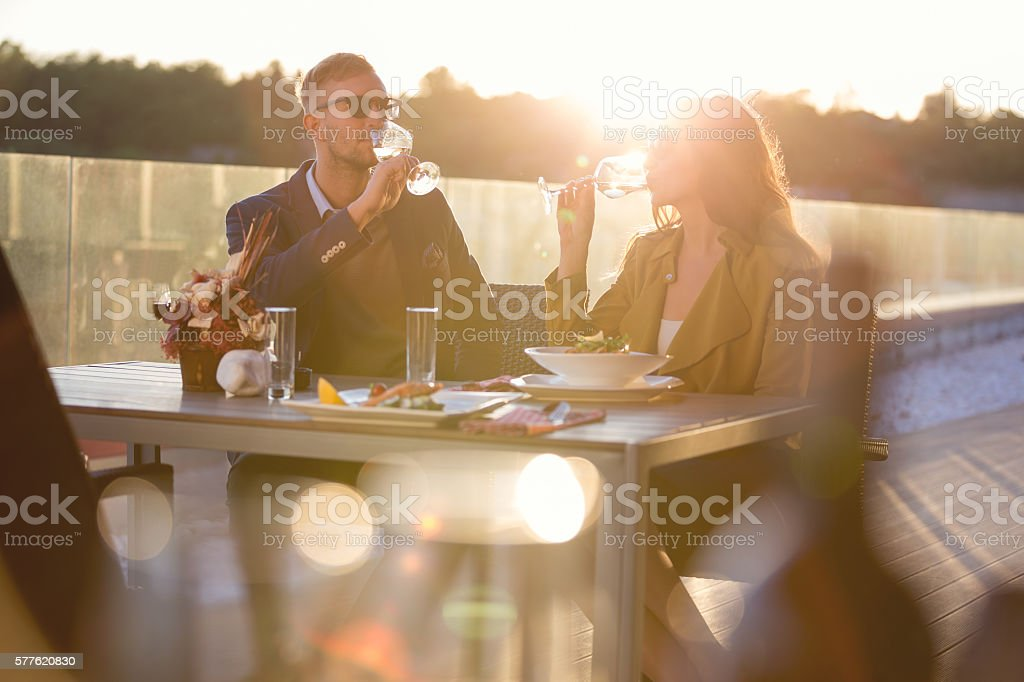 Couple having wine in outdoor restaurant stock photo