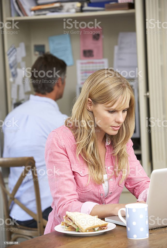 Couple Having Working Lunch In Home Office royalty-free stock photo