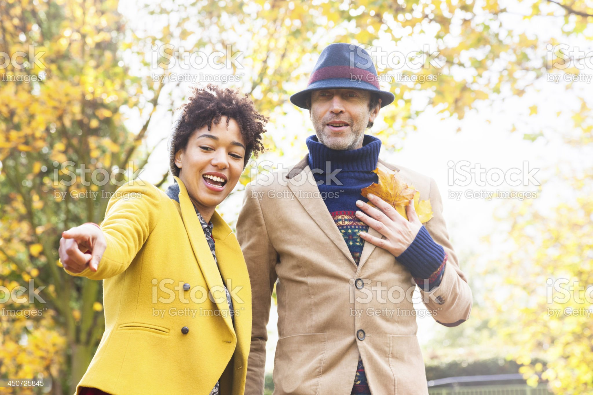 Couple heaving fun in the park royalty-free stock photo