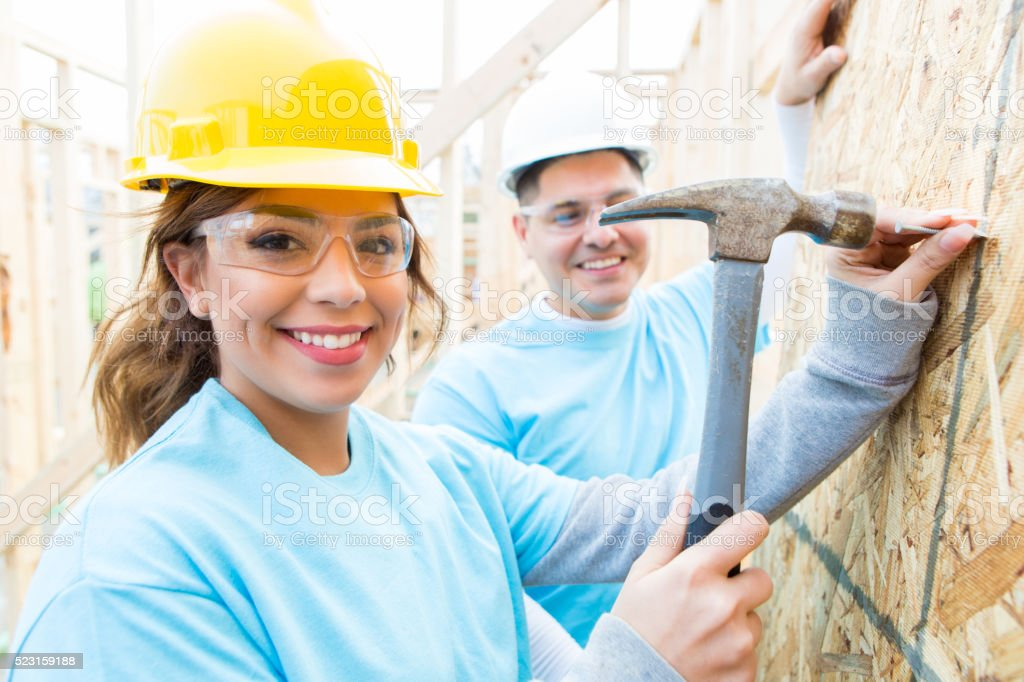 Couple helps build charity home stock photo
