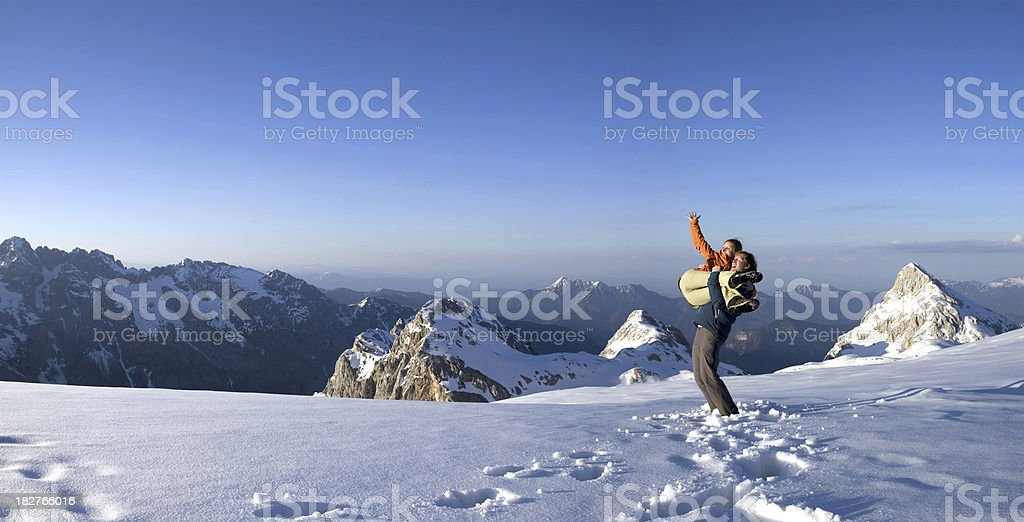 Couple high in the mountains royalty-free stock photo