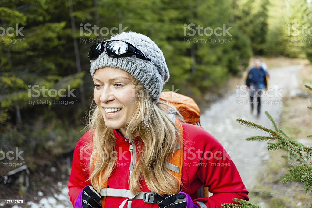 Couple hikers hiking in forest XXXL royalty-free stock photo