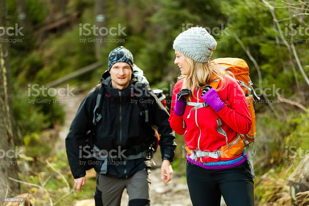 Couple hikers in mountains royalty-free stock photo