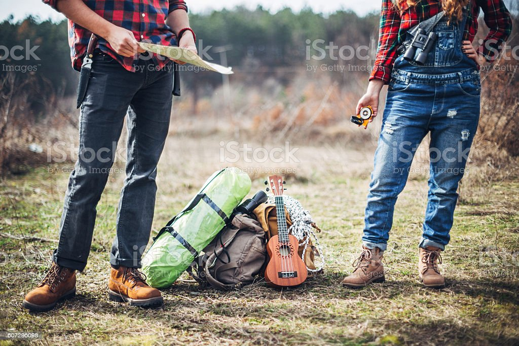 Couple Hikers looking for perfect campsite stock photo