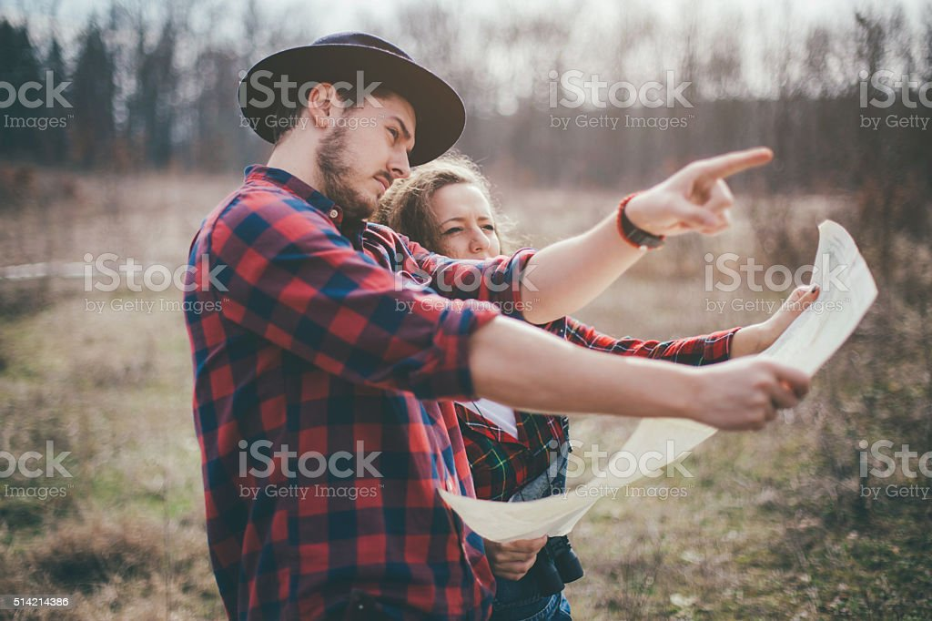 Couple Hikers making a plan with a hiking map stock photo