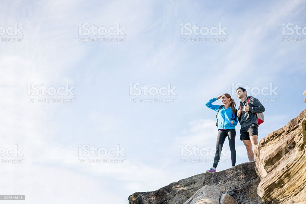 Couple hiking and looking at the view stock photo