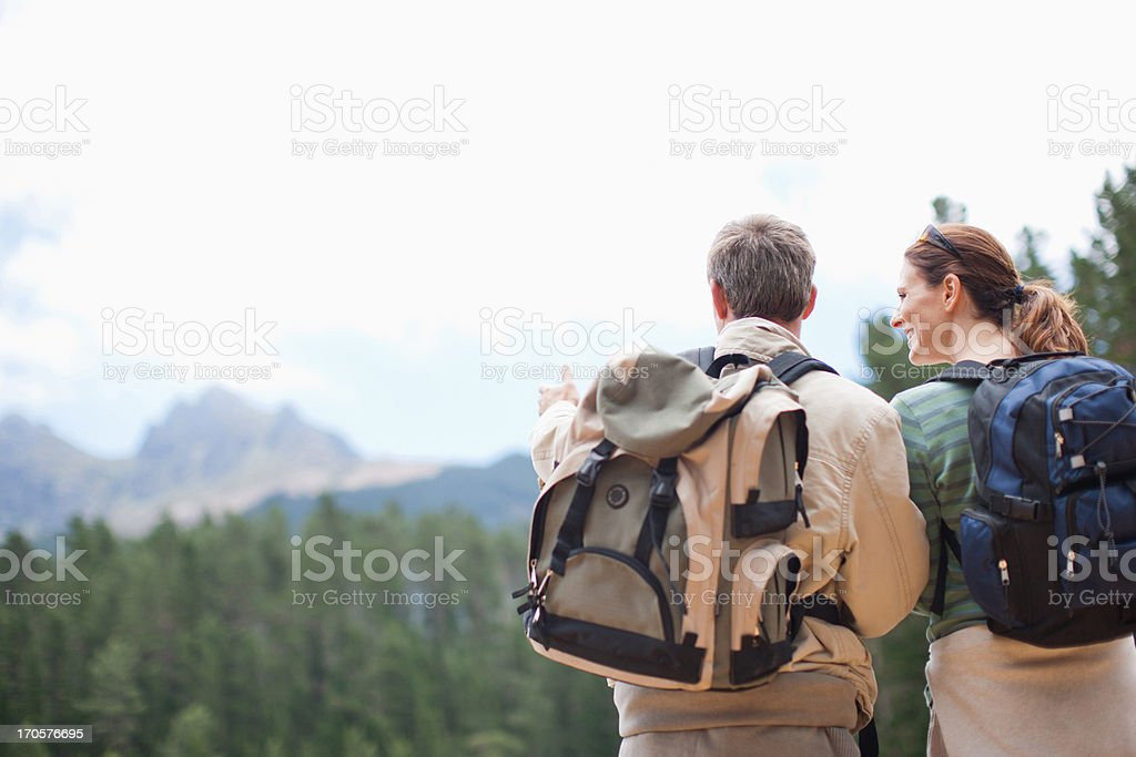Couple hiking and looking in remote area royalty-free stock photo