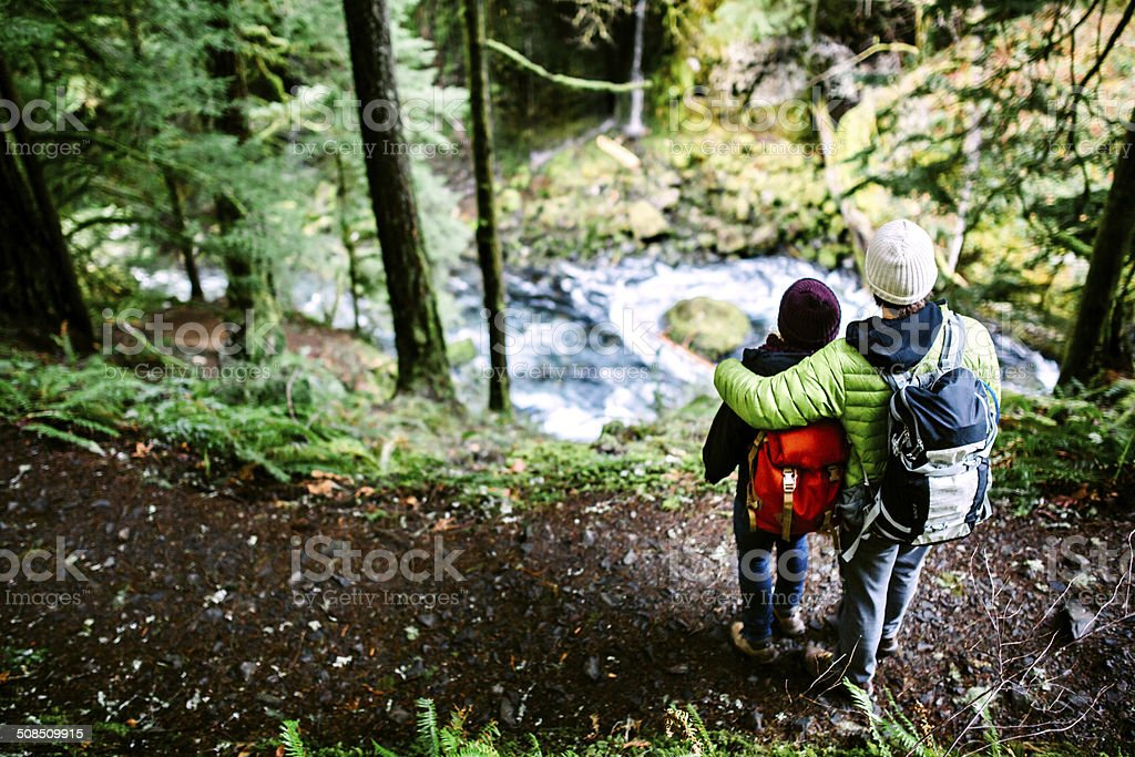 Couple Hiking in Forest Gorge stock photo
