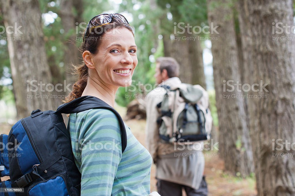 Couple hiking in forest royalty-free stock photo