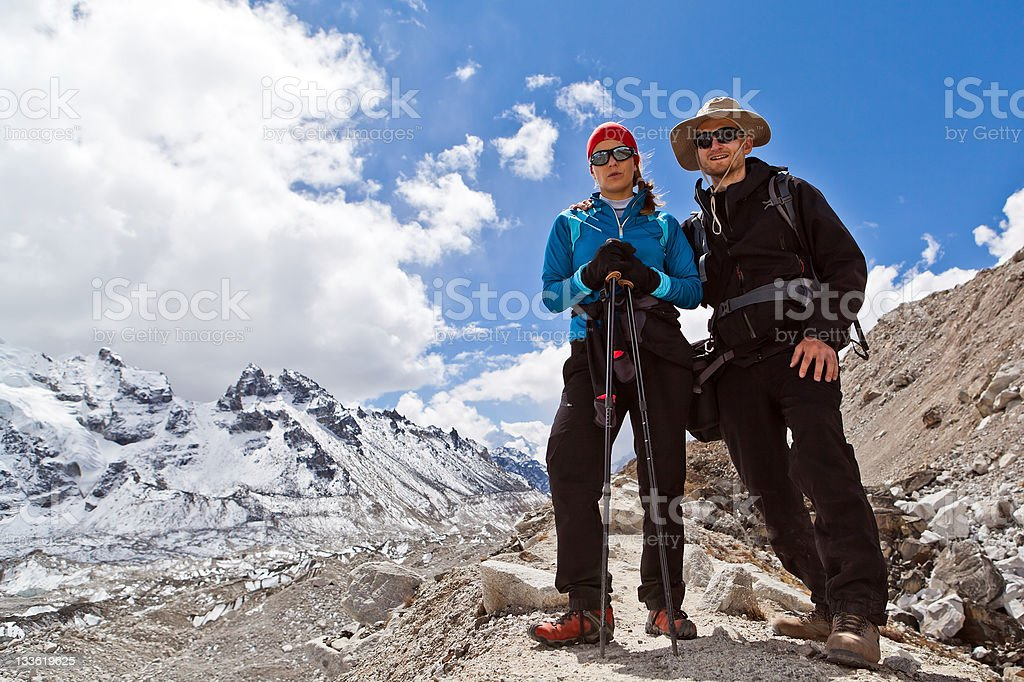 Couple Hiking in Himalaya Mountains royalty-free stock photo