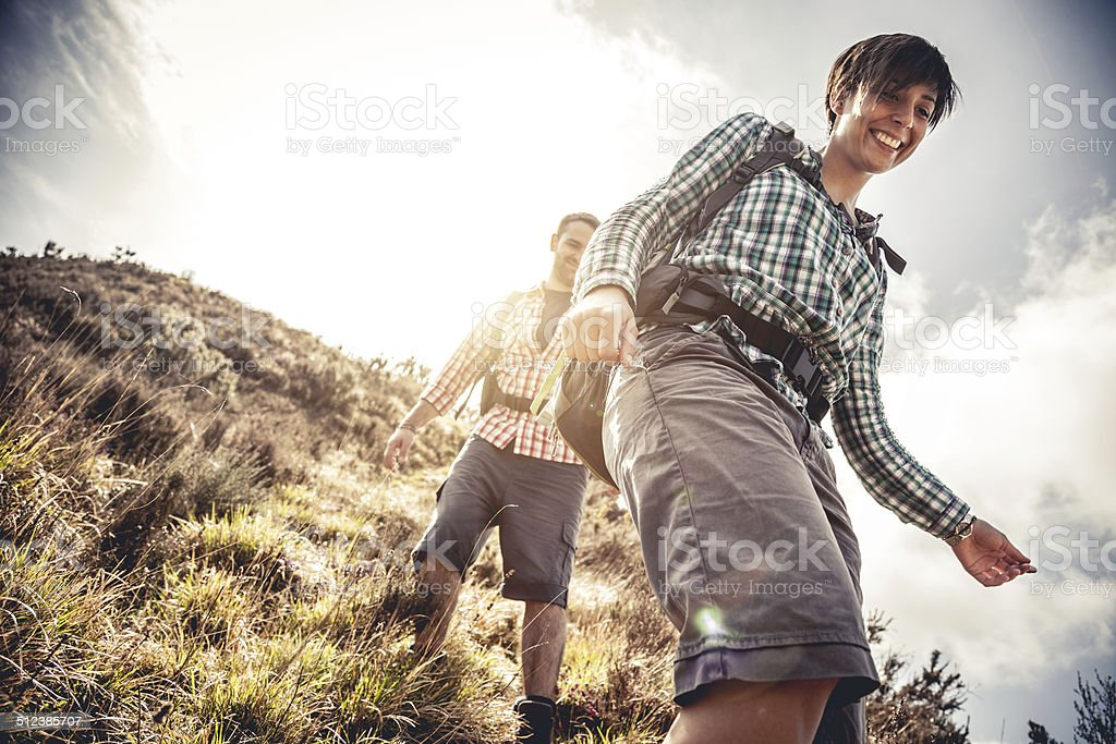 Couple hiking in mountain stock photo