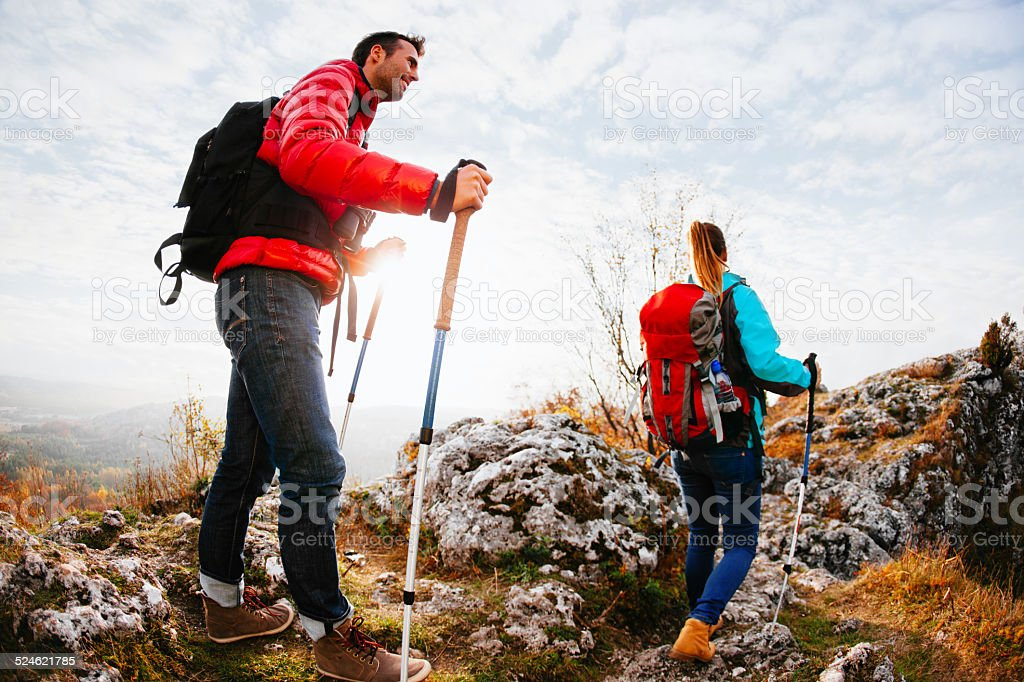 Couple hiking in mountains stock photo
