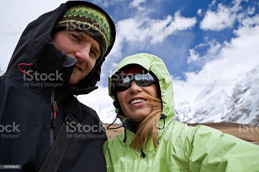 Couple hiking in mountains, self-portrait royalty-free stock photo