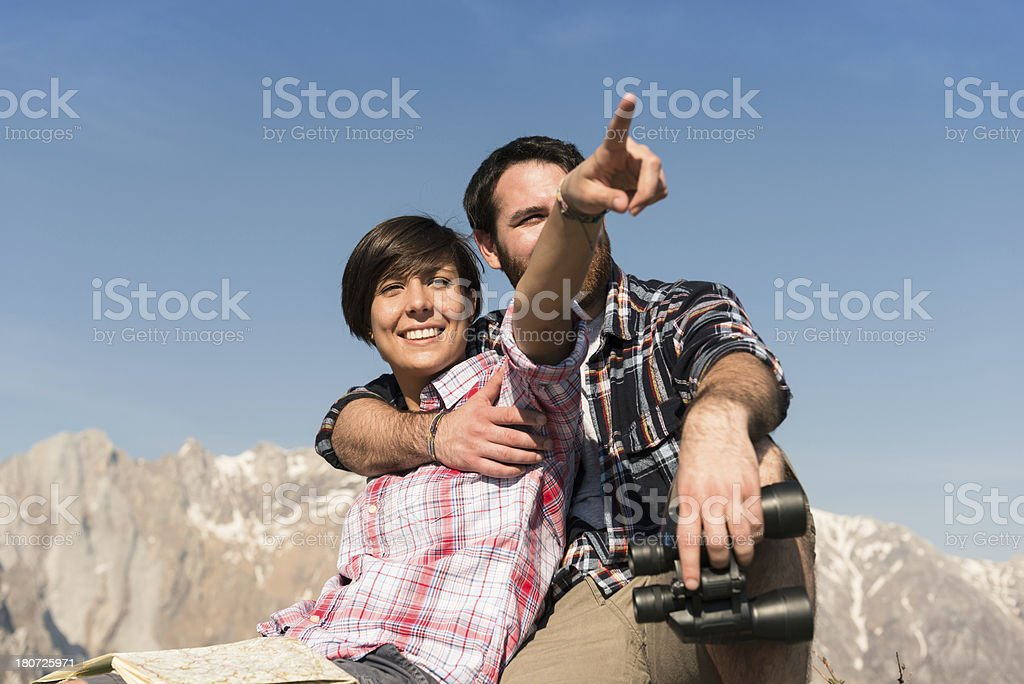 Couple hiking on the mountain and looking forward royalty-free stock photo