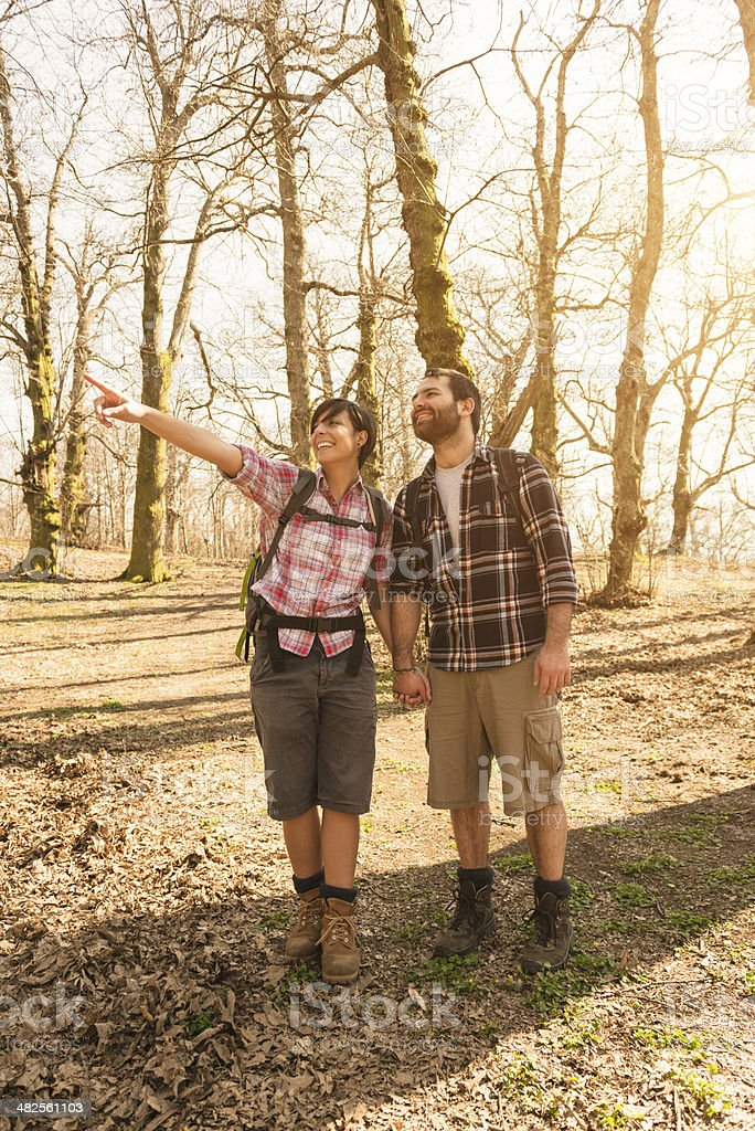 couple hiking on the wood royalty-free stock photo