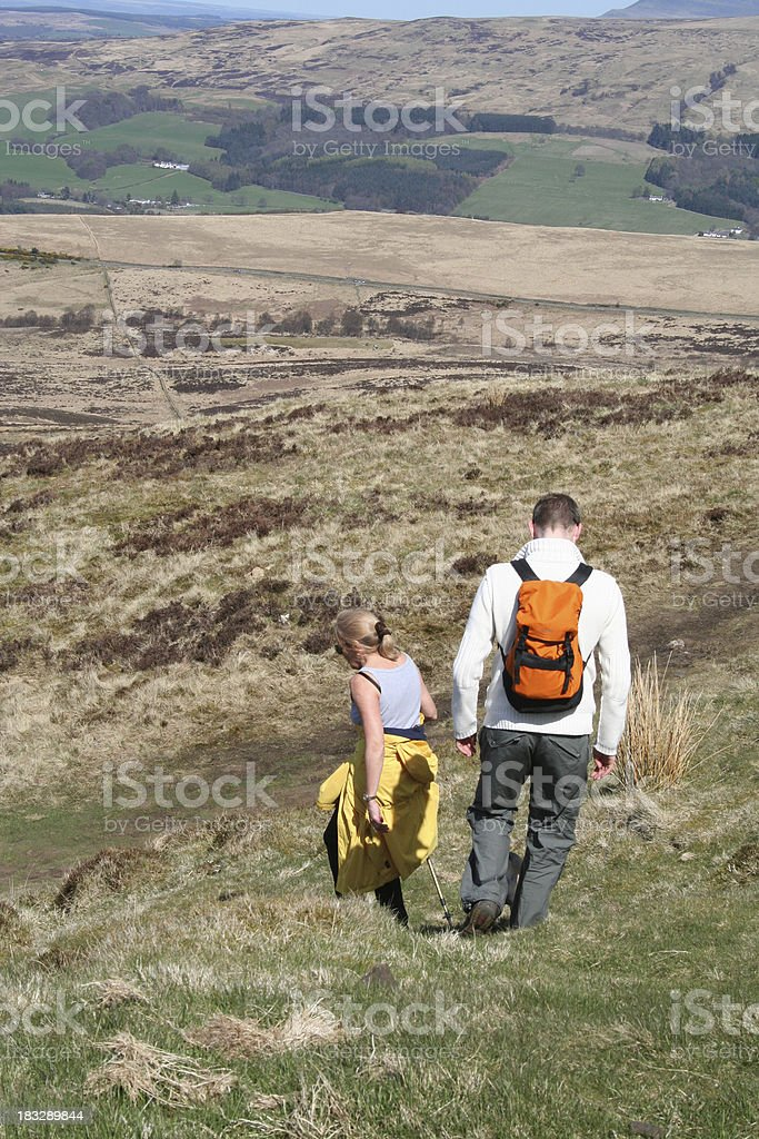 Couple hill walking in Scotland royalty-free stock photo
