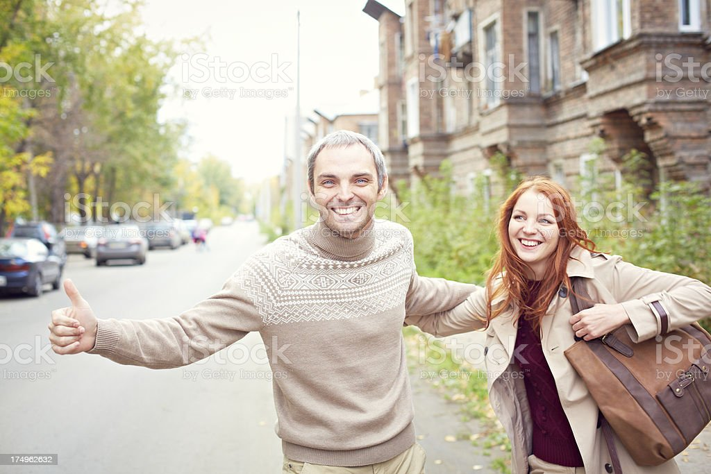Couple hitchhiking royalty-free stock photo