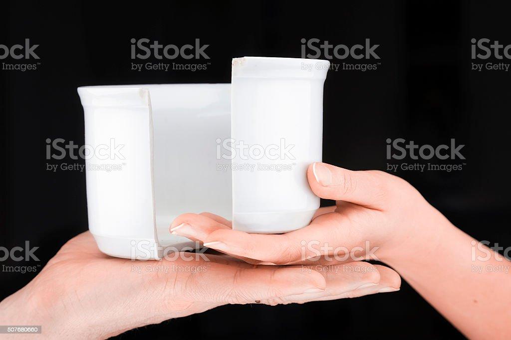 Couple  holding a broken mug stock photo