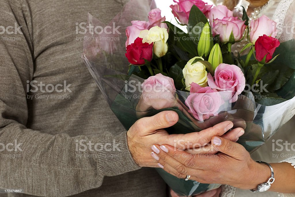 Couple holding a flower bouquet royalty-free stock photo