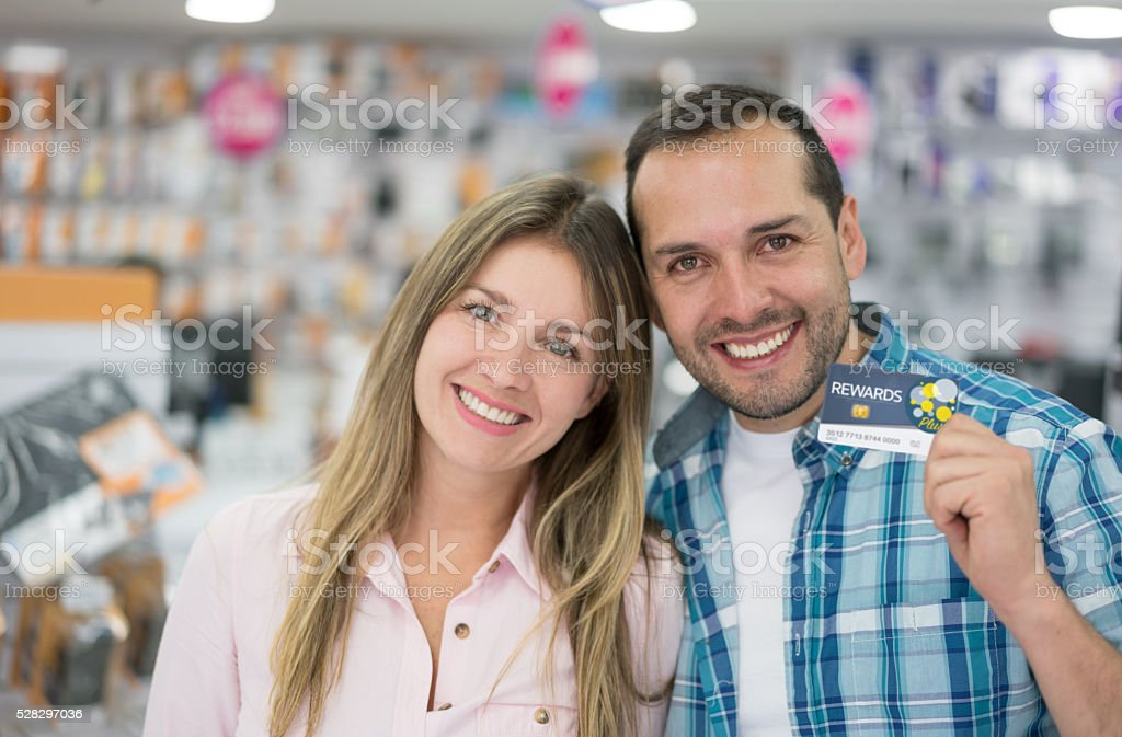 Couple holding a loyalty card stock photo
