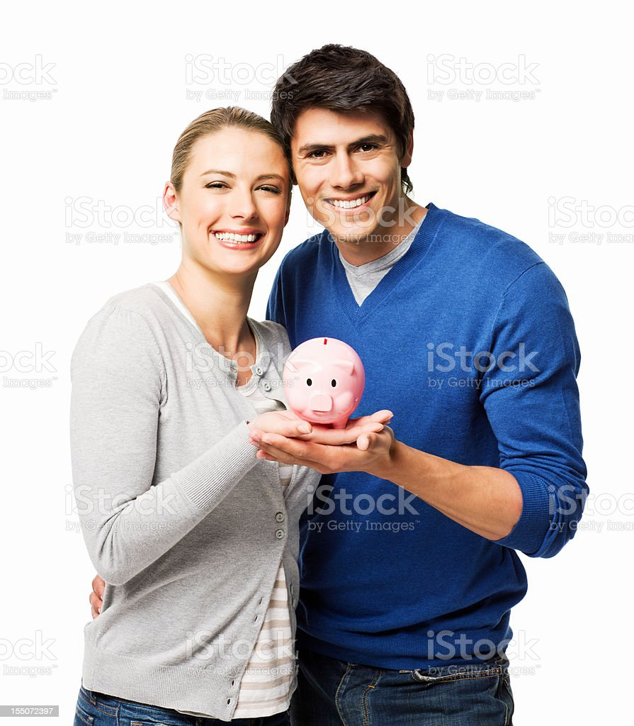 Couple Holding a Piggy Bank - Isolated royalty-free stock photo