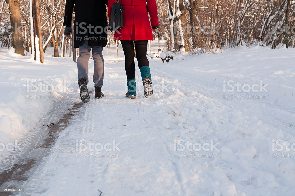 Couple holding each other's hands going through the park stock photo