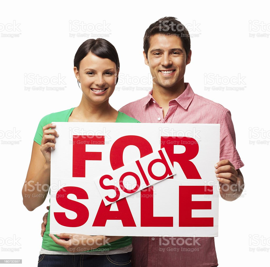 Couple Holding For Sale and Sold Sign Board - Isolated royalty-free stock photo