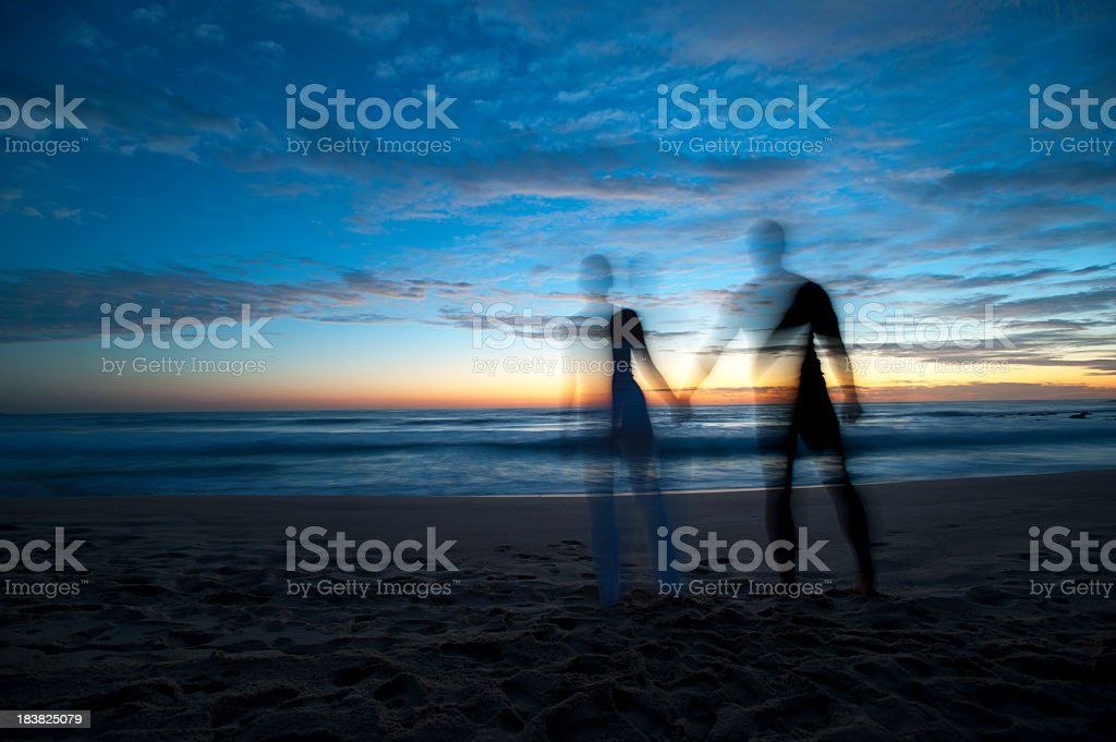 Couple holding hands at sunrise. Motion blur royalty-free stock photo