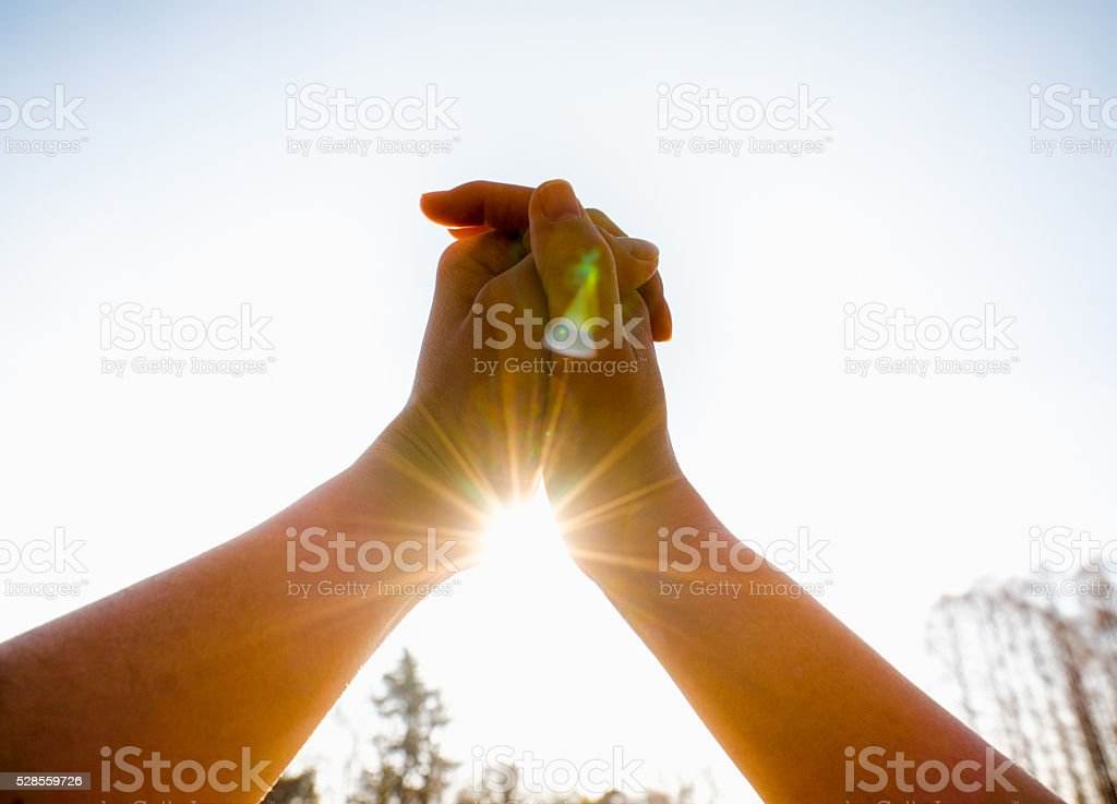 Couple holding hands each other stock photo