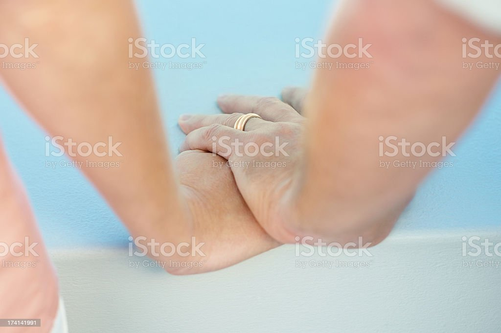 Couple holding hands , focus on with wedding ring stock photo