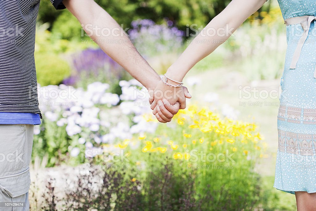 Couple holding hands in park royalty-free stock photo
