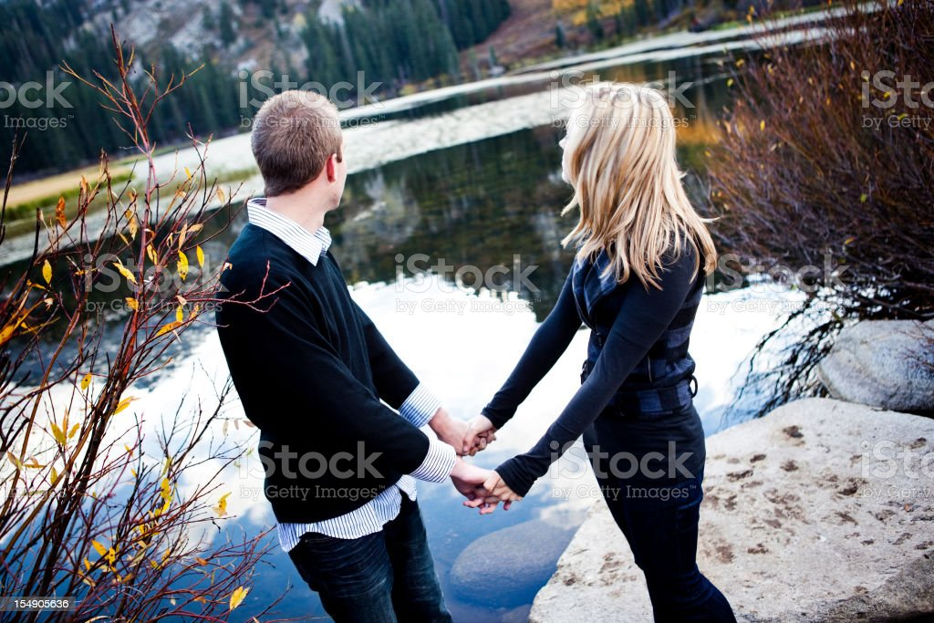 Couple Holding Hands in the Mountains stock photo