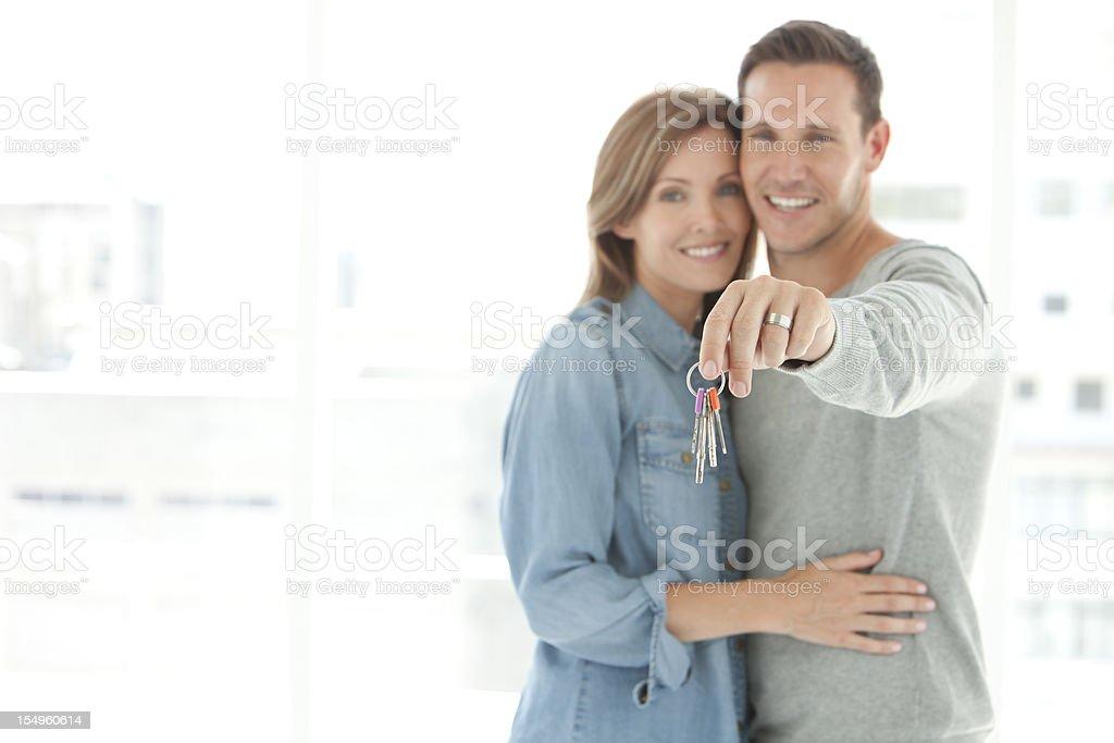 Couple holding home keys stock photo