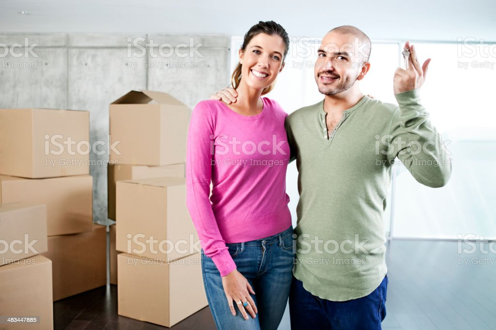 Couple holding house key stock photo