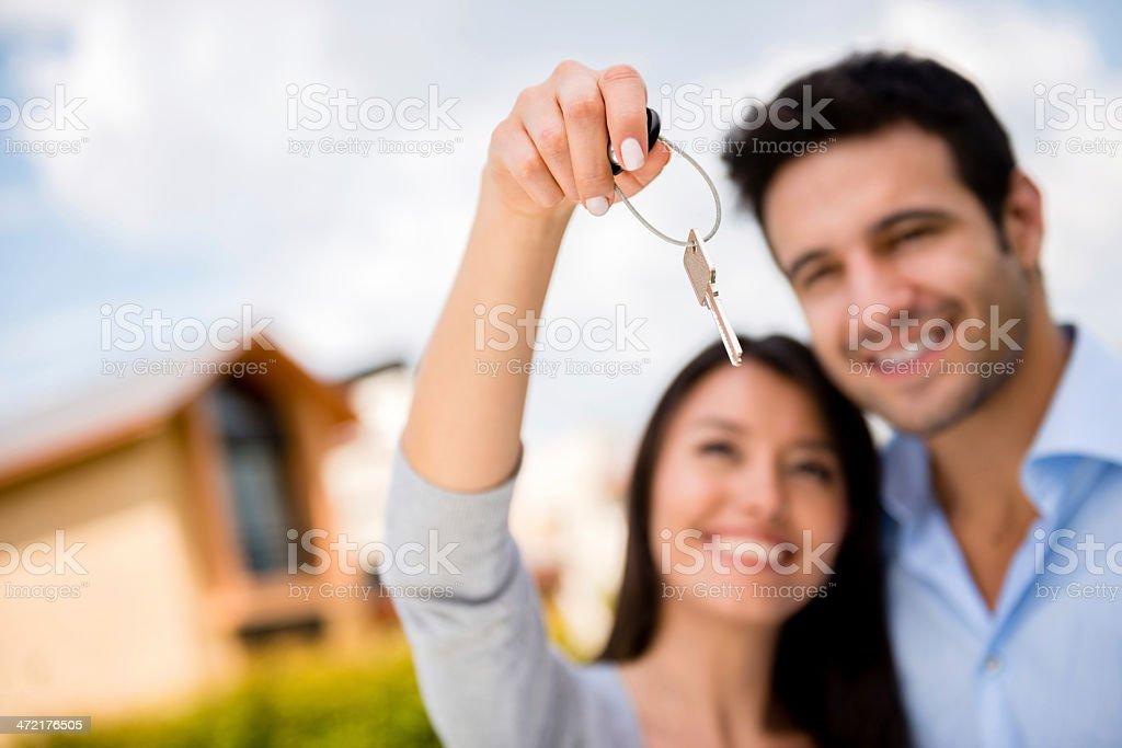 Couple holding house keys stock photo