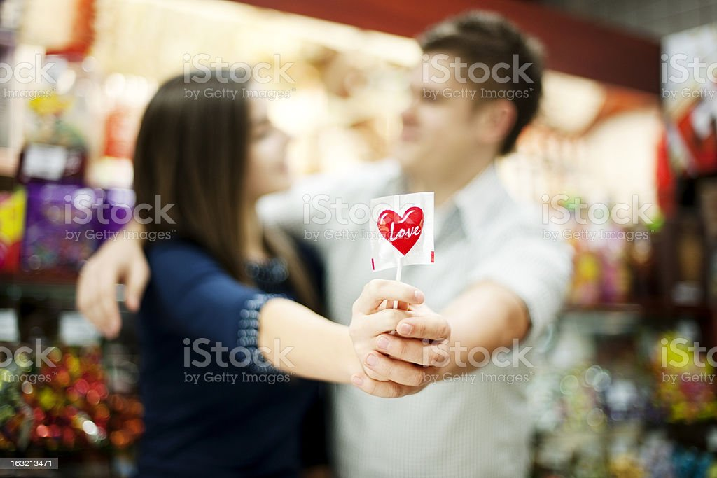 Couple holding lollipop in their hands royalty-free stock photo