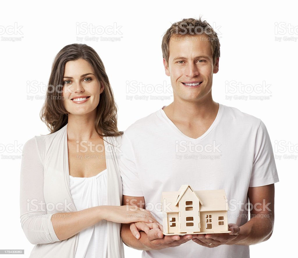 Couple Holding Model Home - Isolated royalty-free stock photo