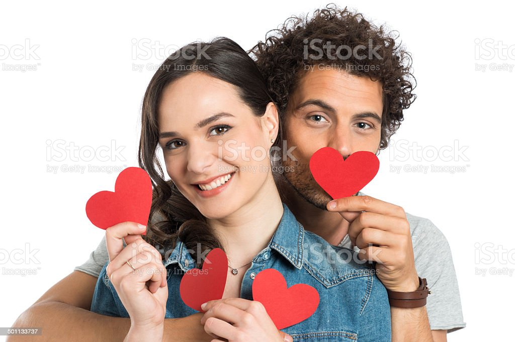 Couple Holding Paper Heart stock photo