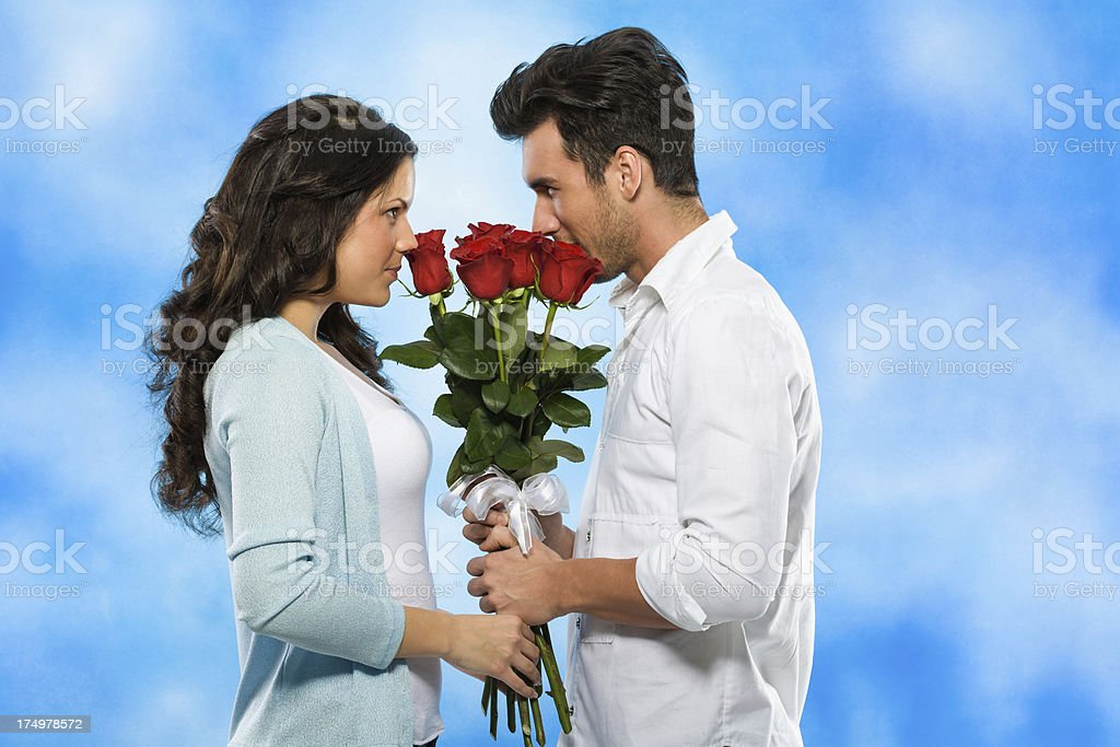Couple holding roses together royalty-free stock photo