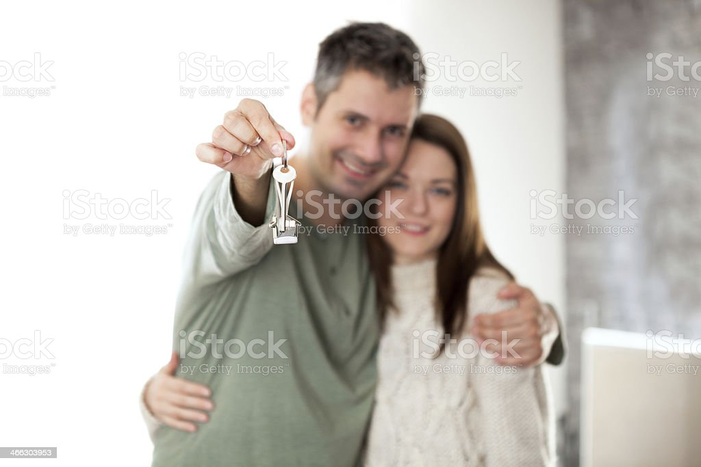 Couple holding up a set of keys stock photo