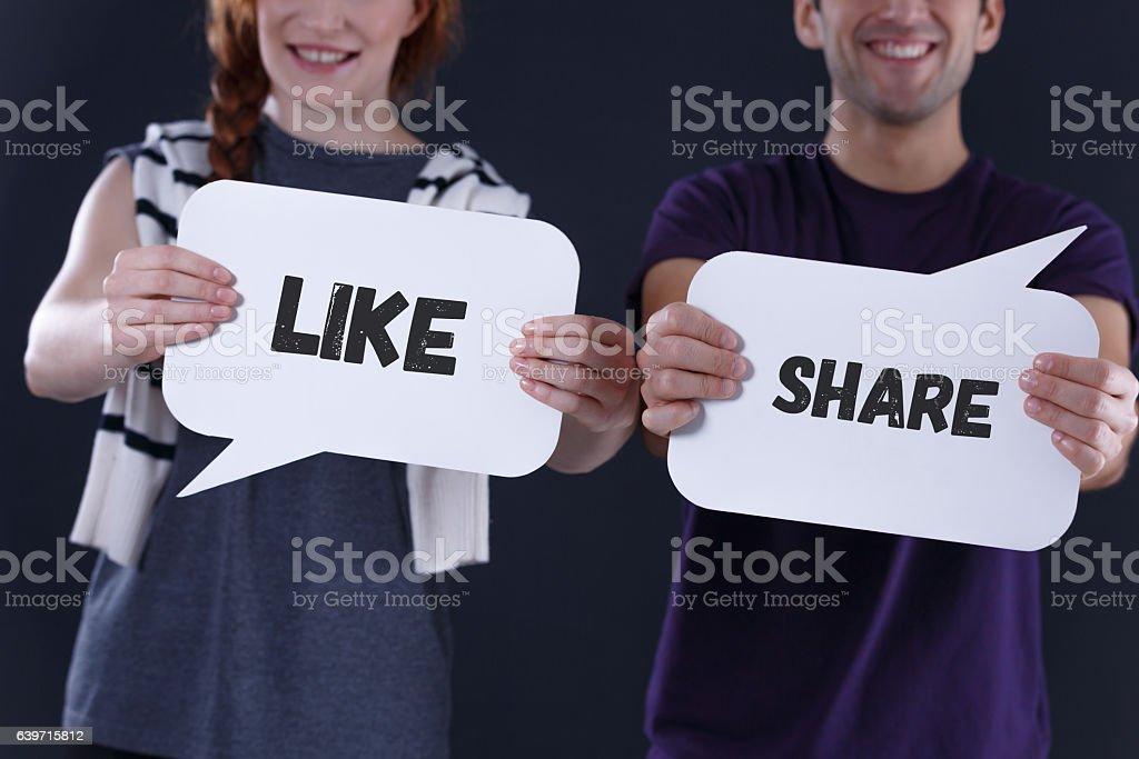 Couple holding word balloons stock photo