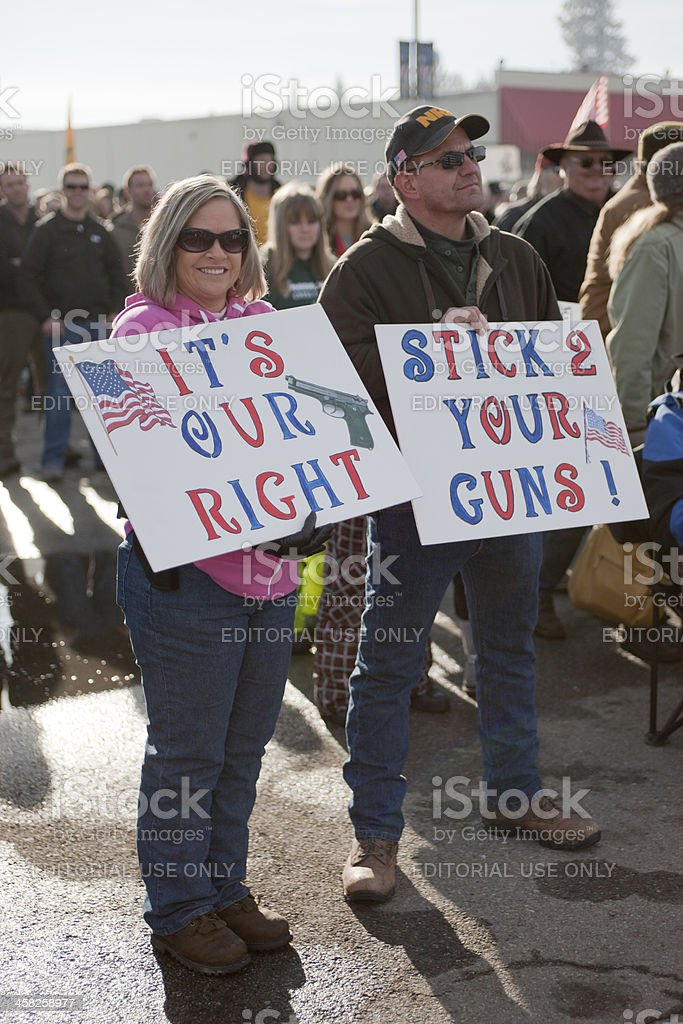 Couple holds signs at rally. royalty-free stock photo