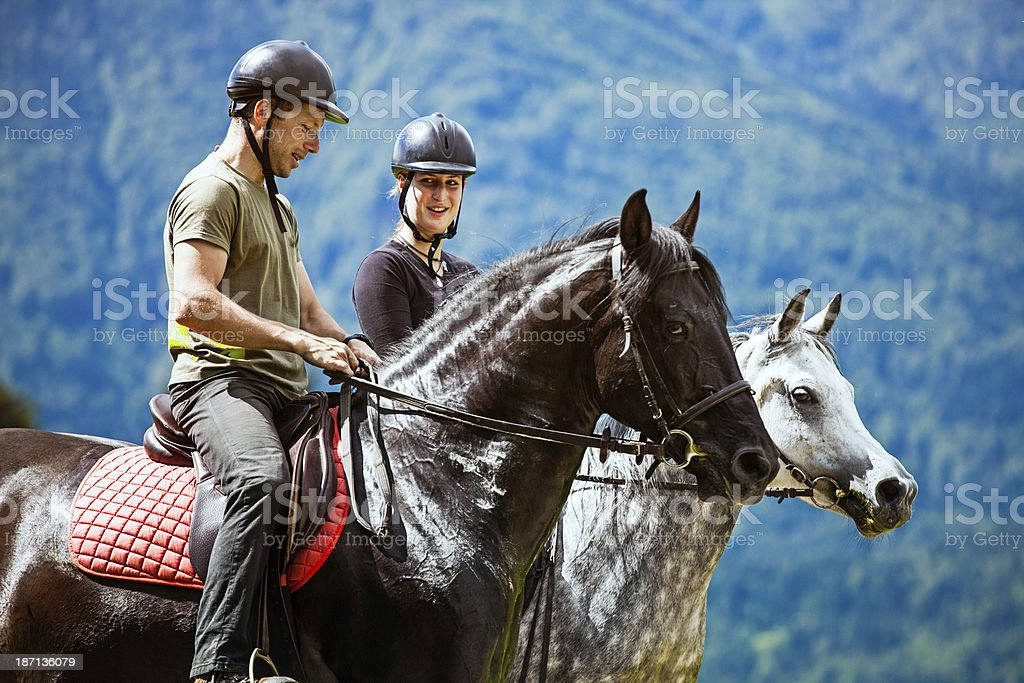 Couple Horseback Riding In The Countryside royalty-free stock photo