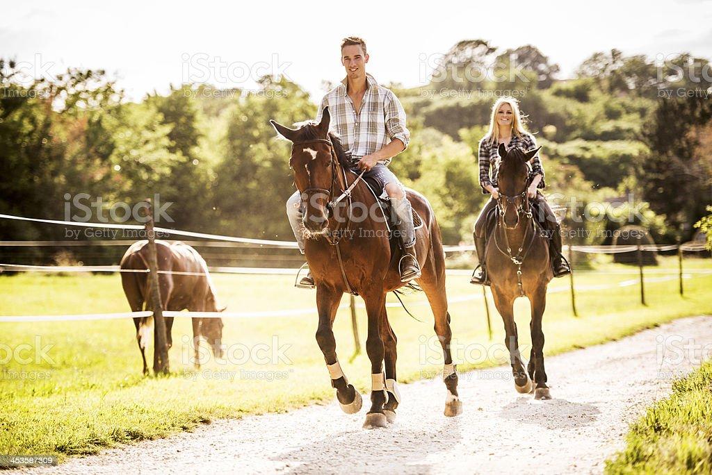 Couple horseback riding. stock photo