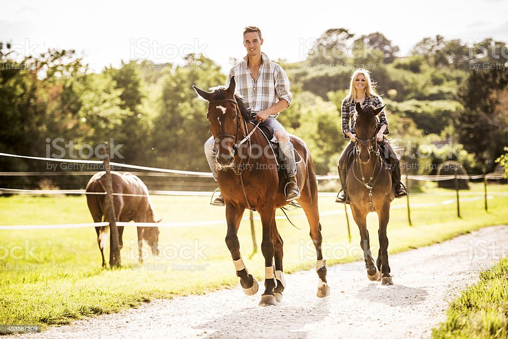 Couple horseback riding. stock photo