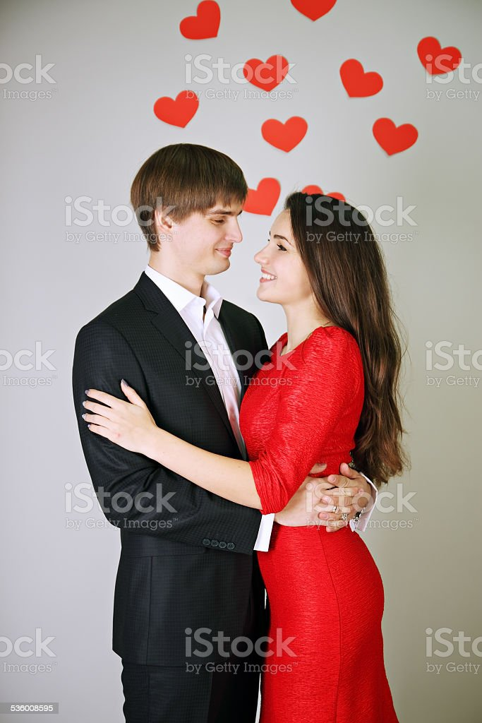 couple hugging each other stock photo